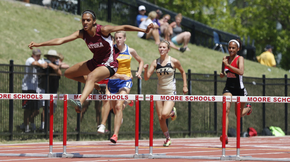 Photo - Makayla Stephens, Atoka, wins the girls 300 meter hurdles during the Class 3A-4A state track meet at Moore Stadium on Saturday, May 10, 2014 in Moore, Okla.  Photo by Steve Sisney, The Oklahoman