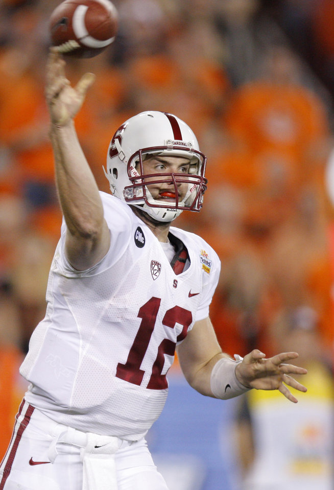 Photo - Stanford's Andrew Luck (12) throws a pass during the Fiesta Bowl between the Oklahoma State University Cowboys (OSU) and the Stanford Cardinal at the University of Phoenix Stadium in Glendale, Ariz., Monday, Jan. 2, 2012. Photo by Bryan Terry, The Oklahoman