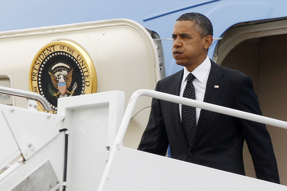 Photo -   President Barack Obama steps off Air Force One at Andrews Air Force Base, Md. upon his return from Afghanistan, Wednesday, May 2, 2012. (AP Photo/Charles Dharapak)