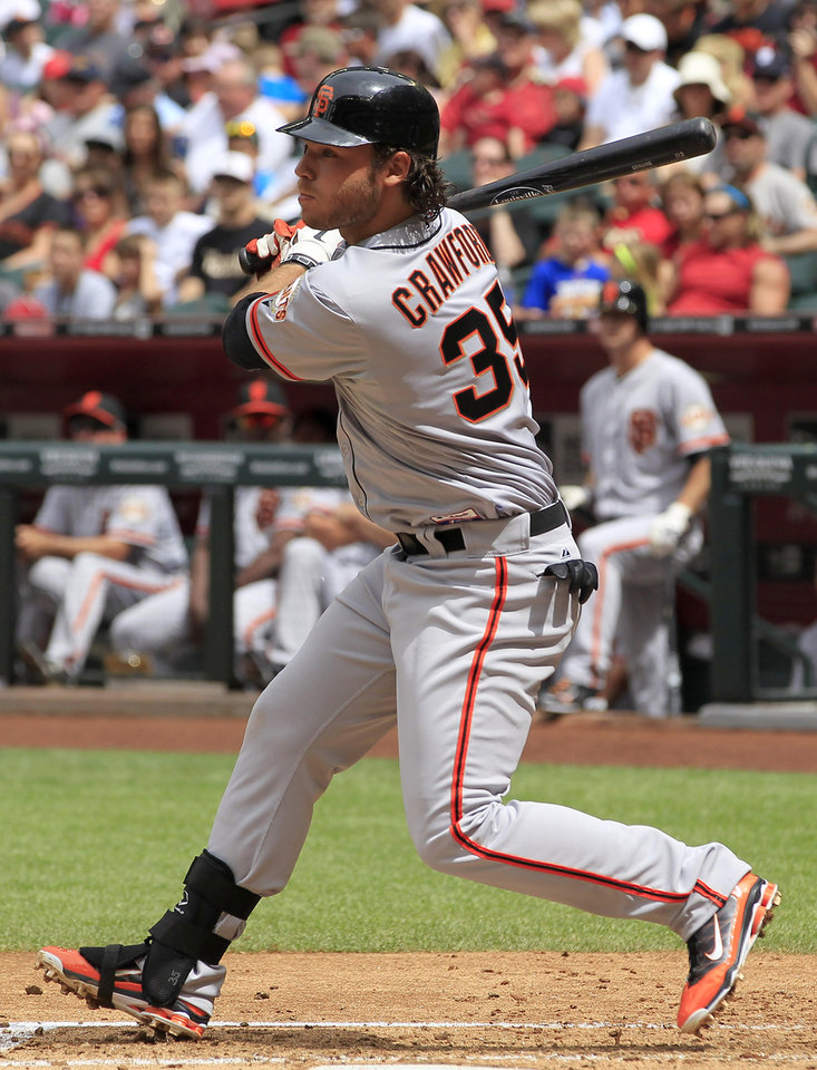 Photo -   San Francisco Giants' Brandon Crawford watches his two-run double head down the left field line against the Arizona Diamondbacks during the second inning in an MLB baseball game Sunday, April 8, 2012, in Phoenix.(AP Photo/Ross D. Franklin)