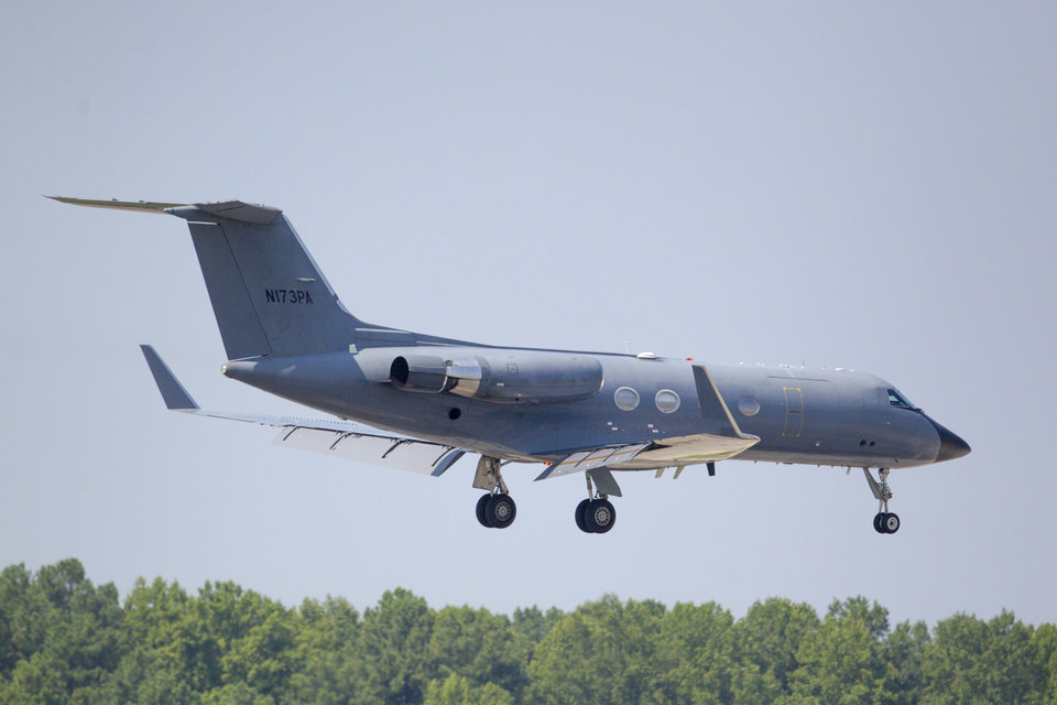 Photo - A private plane arrives at Dobbins Air Reserve Base transporting a second American missionary stricken with Ebola, Tuesday, Aug. 5, 2014, in Marietta, Ga. Nancy Writebol is expected to be admitted to Atlanta's Emory University Hospital on Tuesday, where she will join another U.S. aid worker, Dr. Kent Brantly, in a special isolation unit. (AP Photo/Todd Kirkland)