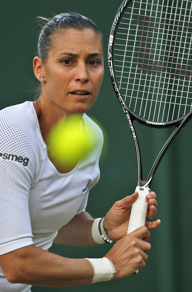 Photo - Flavia Pennetta of Italy plays a return to Lauren Davis of the U.S. during their women's singles match at the All England Lawn Tennis Championships in Wimbledon, London, Wednesday, June 25, 2014. (AP Photo/Pavel Golovkin)