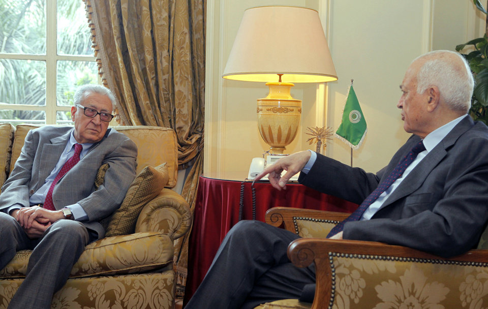 Photo - Arab League Secretary-General Nabil al-Araby, right, meets with U.N.-Arab League international Syria mediator Lakhdar Brahimi at the Arab league headquarters in Cairo, Egypt, Monday, March 18, 2013. The fighting in Syria has settled into a bloody stalemate and shows no signs of stopping, despite several tentative proposals from both sides to find a peaceful resolution to the conflict. (AP Photo/Amr Nabil)