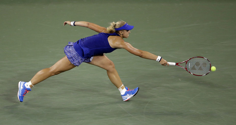 Photo - Sabine Lisicki, of Germany, reaches for a shot by Maria Sharapova, of Russia, during the third round of the U.S. Open tennis tournament, Friday, Aug. 29, 2014, in New York. (AP Photo/Darron Cummings)