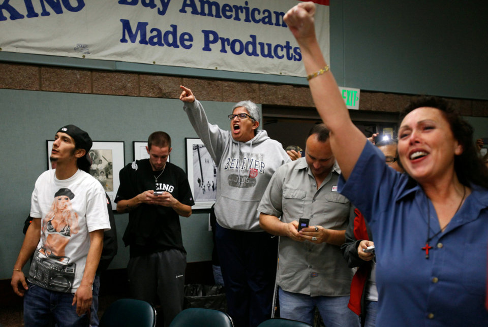 Photo - Union members celebrate the turn down of the proposed Boeing Corporation contract and heckle IAM District 751 President Tom Wroblewski Wednesday night Nov. 13, 2013 at the Internal Association of Machinists District 751 Headquarters in Seattle, Nov. 13, 2013.  The vote would have secured production of the new Boeing 777x for the Seattle area in exchange for heavy worker contract cuts.  The union voted to turn down the new contract by 67 percent. (AP Photo/The Herald, Genna Martin)
