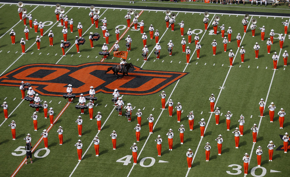 Photo - Bullet runs on to the field before a college football game between the Oklahoma State Cowboys (OSU) and the Pitt Panthers at Boone Pickens Stadium in Stillwater, Okla., Saturday, Sept. 17, 2016. Photo by Sarah Phipps, The Oklahoman