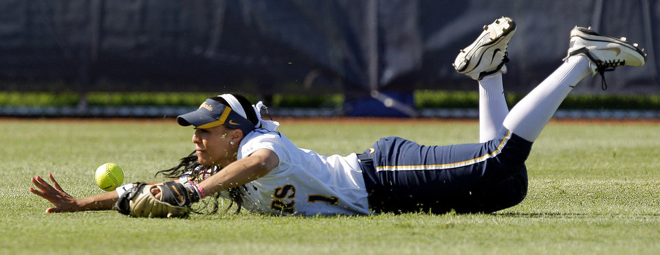 California's Frani Echavarria dives for the ball in the seventh inning of their  Women's College World Series game against LSU at ASA Hall of Fame Stadium in Oklahoma City, Thursday, May 31, 2012.  Photo by Bryan Terry, The Oklahoman