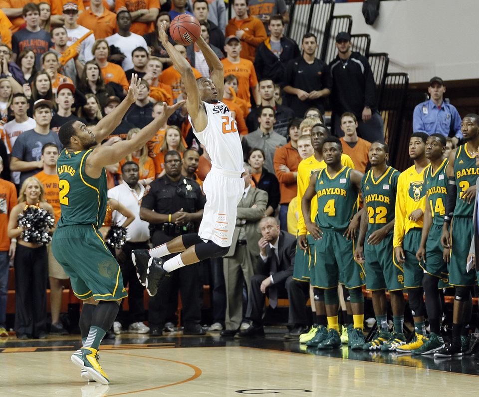 Oklahoma State 's Markel Brown (22) steals the pass to Baylor's Rico Gathers (2) that ended the 69-67 win over Baylor during the college basketball game between the Oklahoma State University Cowboys (OSU) and the Baylor University Bears (BU) at Gallagher-Iba Arena on Wednesday, Feb. 5, 2013, in Stillwater, Okla. Photo by Chris Landsberger, The Oklahoman