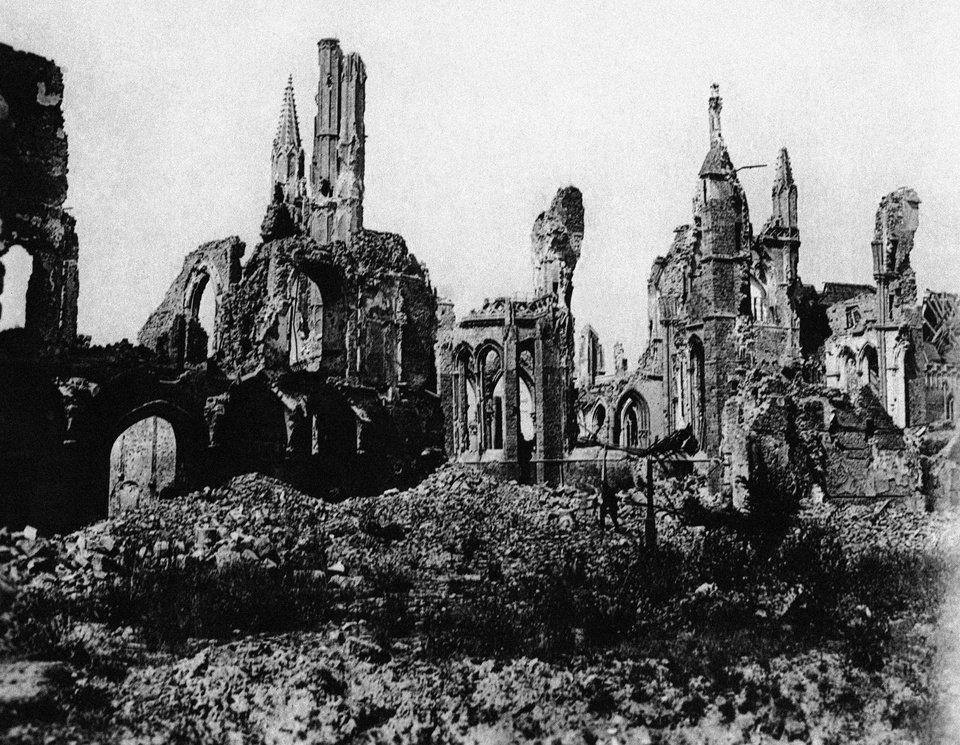 Photo - FILE- In this undated file photo, the cathedral in the town square of Ypres, Belgium, is in ruins after the bombing during World War I. One hundred years after the war began, Tour de France organizers have decided to mark the anniversary with a series of stages across the northern and eastern French and Belgian battlefields where so many lives were lost. (AP Photo, File)