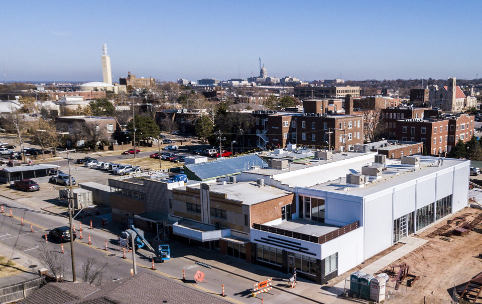 Photo -  Elk Valley Brewery anchors the south end of a development by the Pivot Project that includes conversion of a former theater (middle building with marquee) into a food and retail market and the north end of the building into offices for Resolution Legal Group. [Photo by Dave Morris, The Oklahoman]