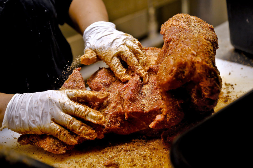 Photo - Meat being seasoned in the kitchen at the new Back Door Barbecue at 315 NW 23 in Oklahoma City. Photo by Chris Landsberger, The Oklahoman  CHRIS LANDSBERGER - CHRIS LANDSBERGER