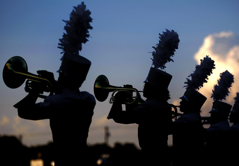 Photo - The Yukon band performs before a high school football game between Yukon and Mustang in Yukon, Okla., Friday, August 31, 2012. Photo by Bryan Terry, The Oklahoman