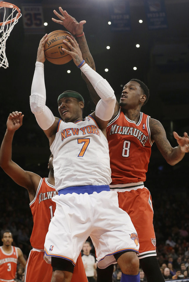 Milwaukee Bucks\' Larry Sanders (8) defends against New York Knicks\' Carmelo Anthony (7) during the first half of an NBA basketball game on Friday, April 5, 2013, in New York. (AP Photo/Frank Franklin II)