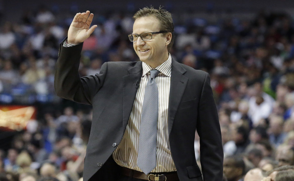 Photo - Oklahoma City Thunder coach Scott Brooks reacts to a call during the first half of an NBA basketball game against the Dallas Mavericks on Tuesday, March 25, 2014, in Dallas. (AP Photo/LM Otero)