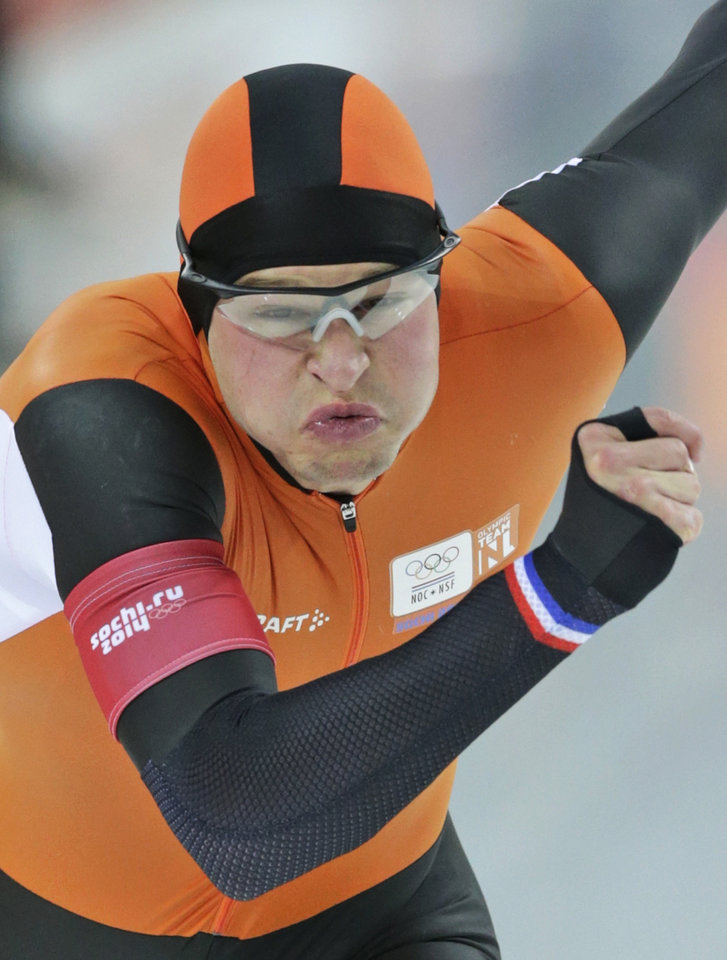 Photo - Sven Kramer of the Netherlands grimaces as he takes the start on his way to a new Olympic record in the men's 5,000-meter speedskating race at the Adler Arena Skating Center at the 2014 Winter Olympics in Sochi, Russia, Saturday, Feb. 8, 2014. (AP Photo/Matt Dunham)