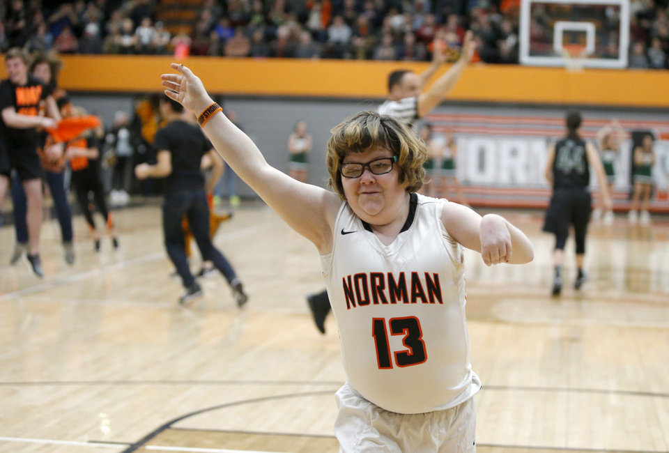 Photo - Norman's Lainy Fredrickson celebrates after making a basket during a game against Norman North at Norman High School, Friday, Feb. 3, 2017. Photo by Bryan Terry, The Oklahoman