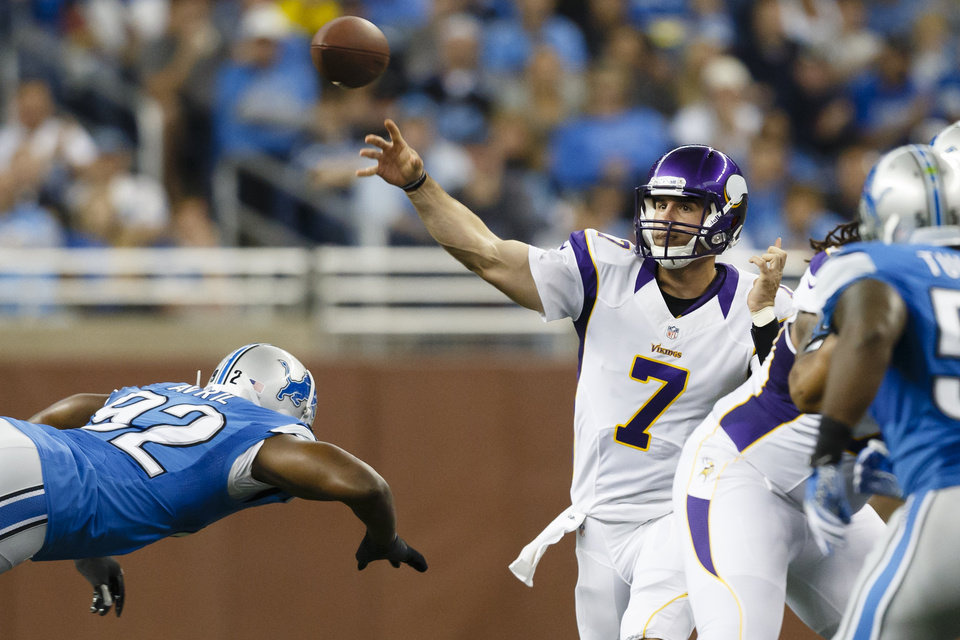 Minnesota Vikings quarterback Christian Ponder (7) passes the ball as Detroit Lions defensive end Cliff Avril (92) rushes during the first half in Detroit, Sunday, Sept. 30, 2012. (AP Photo/Rick Osentoski)