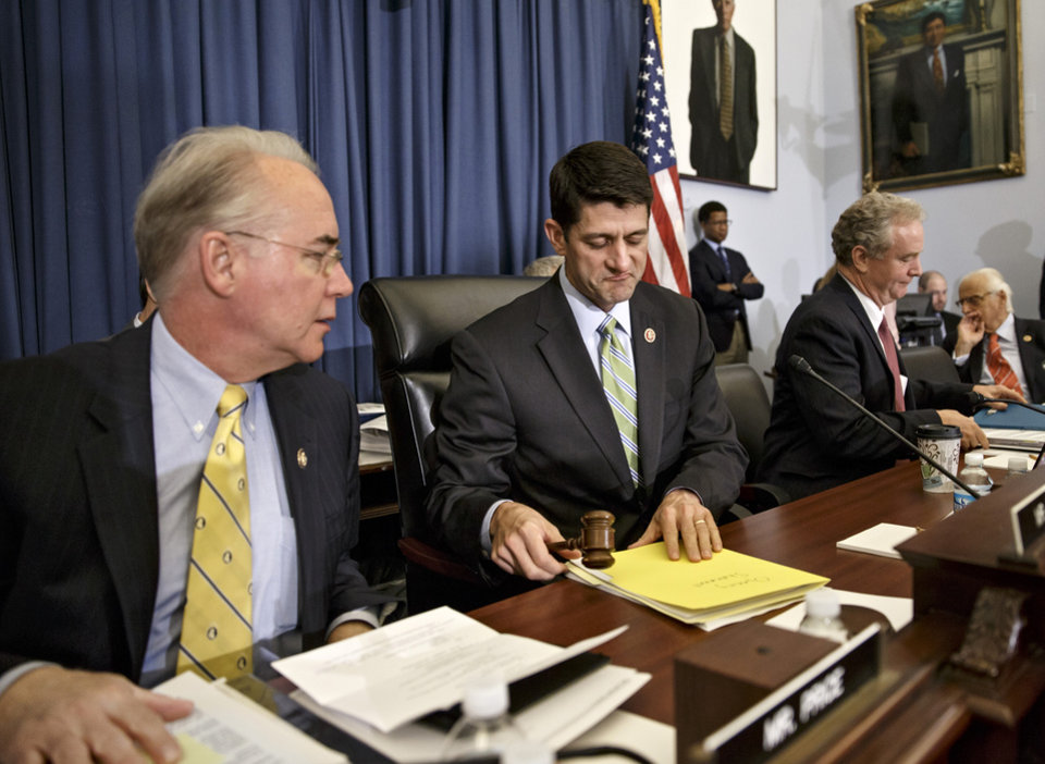 Photo - House Budget Committee Chairman Rep. Paul Ryan, R-Wis., center, flanked by committee member Rep. Tom Price, R-Ga., left, and the committee's ranking member Rep. Chris Van Hollen, D-Md., begins the markup of budget plan that would slash $5.1 trillion in federal spending over coming decade and promises to balance the government's books with wide-ranging cuts in programs like food stamps and government-paid health care for the poor and working class, Wednesday, April 2, 2014, on Capitol Hill in Washington. (AP Photo/J. Scott Applewhite)