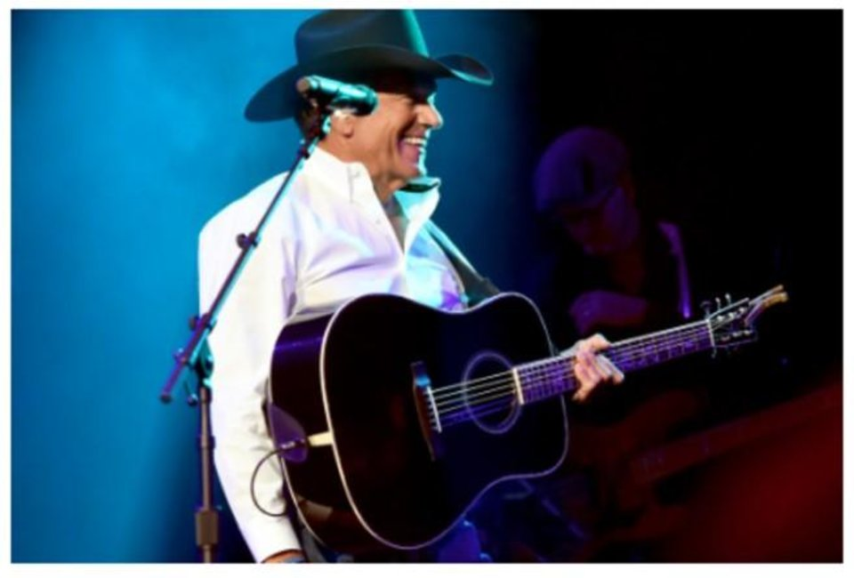 Photo - George Strait performs at the Country Rising benefit concert Sunday at Nashville's Bridgestone Arena. Photos provided courtesy of Getty