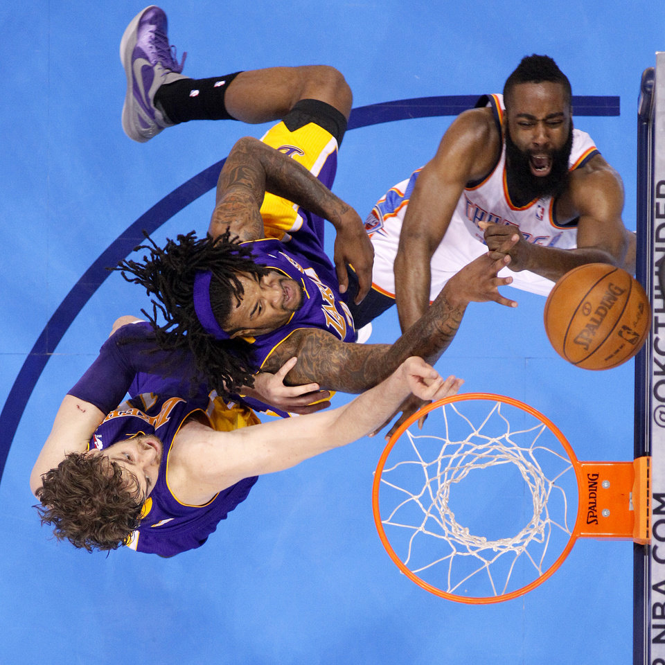 Photo - Oklahoma City's James Harden (13) tries to get to the basket beside Los Angeles' Pau Gasol (16) and Jordan Hill (27) during Game 2 in the second round of the NBA playoffs between the Oklahoma City Thunder and L.A. Lakers at Chesapeake Energy Arena in Oklahoma City, Wednesday, May 16, 2012. Photo by Bryan Terry, The Oklahoman