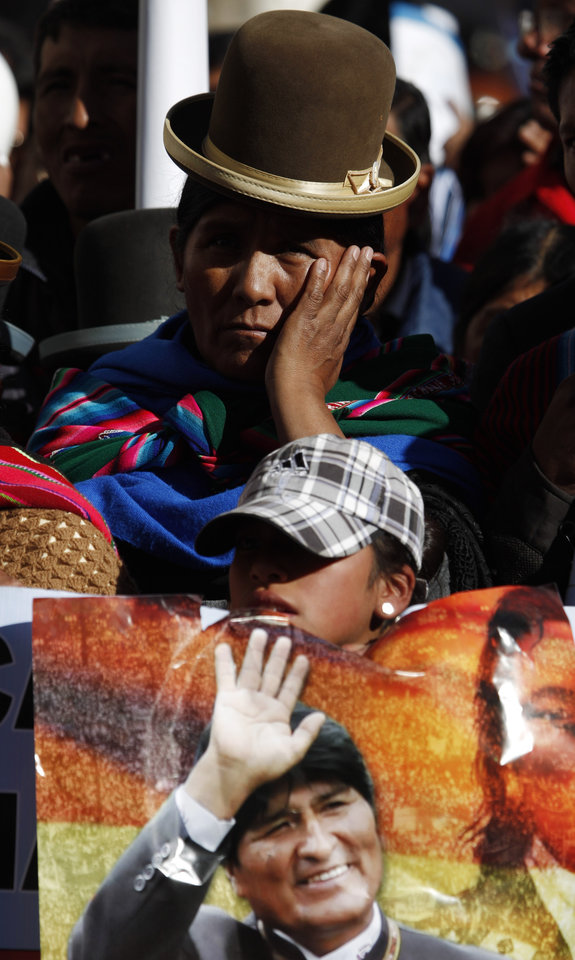 Photo - A woman listens to Bolivia's President Evo Morales talk during the annual May Day march in La Paz, Bolivia, Wednesday, May 1, 2013. Morales said Wednesday he is expelling the USAID from Bolivia for allegedly seeking to undermine his leftist government. (AP Photo/Juan Karita)