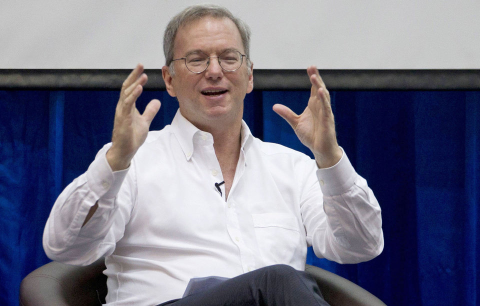 In this Friday, March 22, 2013, Google Executive Chairman Eric Schmidt gestures during  an interactive session with group of students at a technical university in Yangon, Myanmar Schmidt, who spent a decade as the company�s CEO, shares his ruminations and visions of a radically different future in �The New Digital Age,� a book that goes on sale Tuesday, April 23, 2013. (AP Photo/Gemunu Amarasinghe)