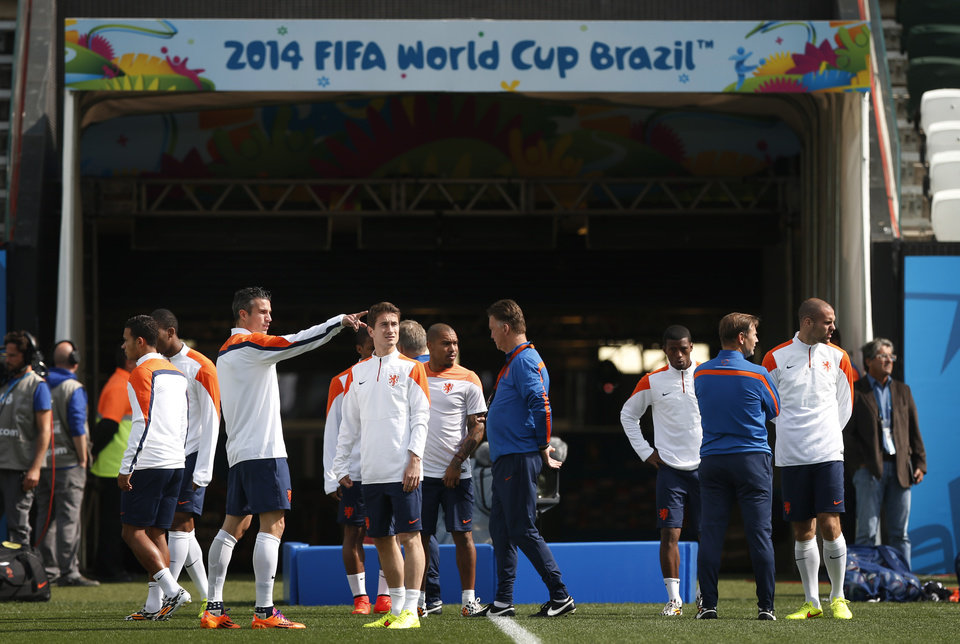 Photo - The Netherlands soccer team arrive for a training session at the Itaquerao Stadium in Sao Paulo, Brazil, Sunday, June 22, 2014.  The Netherlands will play Chile in a match that will decide the winner of Group B at the 2014 soccer World Cup. (AP Photo/Wong Maye-E)