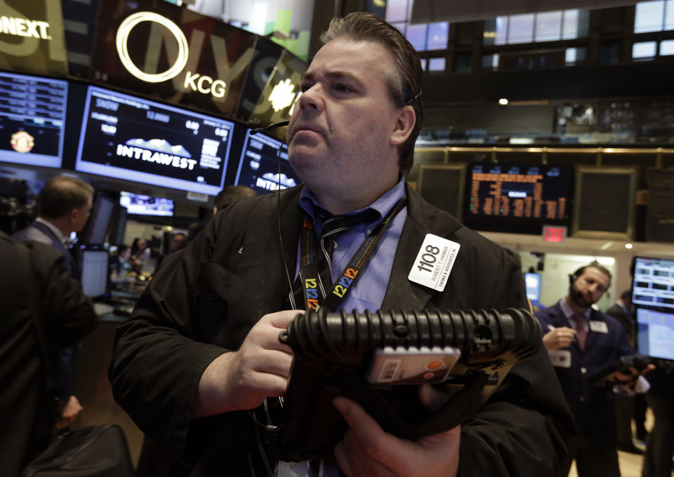 Photo - Trader Robert Hannan works on the floor of the New York Stock Exchange Friday, Jan. 31, 2014. Stocks fell sharply in early trading Friday, as investors fretted over disappointing earnings from companies like Amazon.com and more trouble in overseas markets. (AP Photo/Richard Drew)