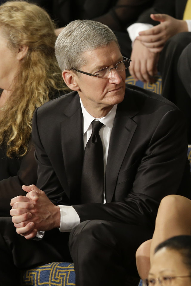 Apple CEO Tim Cook sits as a guest of first lady Michelle Obama prior to the start of President Barack Obama's State of the Union address during a joint session of Congress, Tuesday, Feb.12, 2013,  on Capitol Hill in Washington. (AP Photo/Pablo Martinez Monsivais) ORG XMIT: CAP102