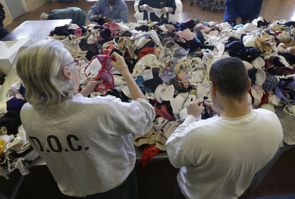 Inmates sort bras that were laundered at Central Maryland Correctional Facility in Sykesville, Md., Thursday, Dec. 13, 2012, as part of a breast cancer awareness campaign. Nearly 10,000 bras were expected to be laundered by the inmates after they were collected by a radio station in Frederick, Md. One dollar for each bra was donated to breast cancer research, and the cleaned bras are expected to be donated to women\'s shelters. Inmates at the facility annually handle more than 2.2 million pounds of laundry from state agencies and non-profit organizations in Maryland. (AP Photo/Patrick Semansky)
