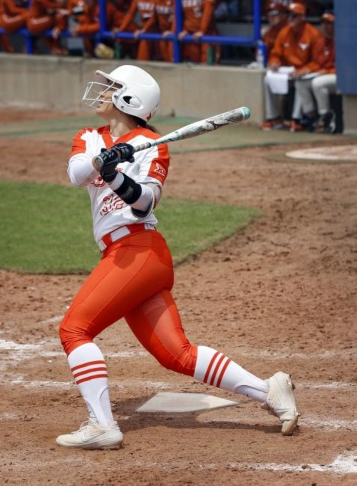 Photo -  OSU's Michaela Richbourg (32) singles in the sixth inning against Texasin the Big 12 softball tournament on Friday. [Nate Billings/The Oklahoman]