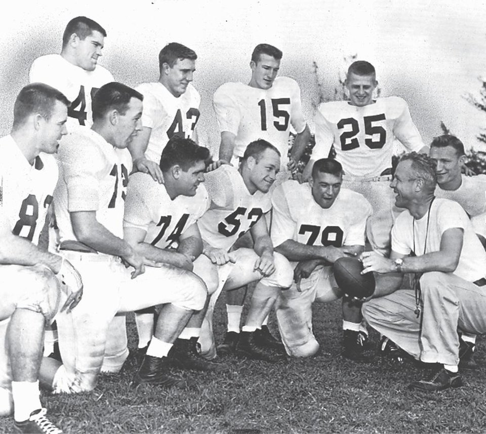 Photo - OU's 1955 road uniform. Worn by top row from left, Robert Burris, Billy Pricer, Jim Harris and Tommy McDonald. On the bottom row are John Bell, Edmon Gray, Cecil Morris, Jerry Tubbs, Bo Bolinger, Wilkinson and Calvin Woodworth. The team was part of OU's 47-game winning streak, which stretched from 1953-57. OKLAHOMAN ARCHIVE PHOTO