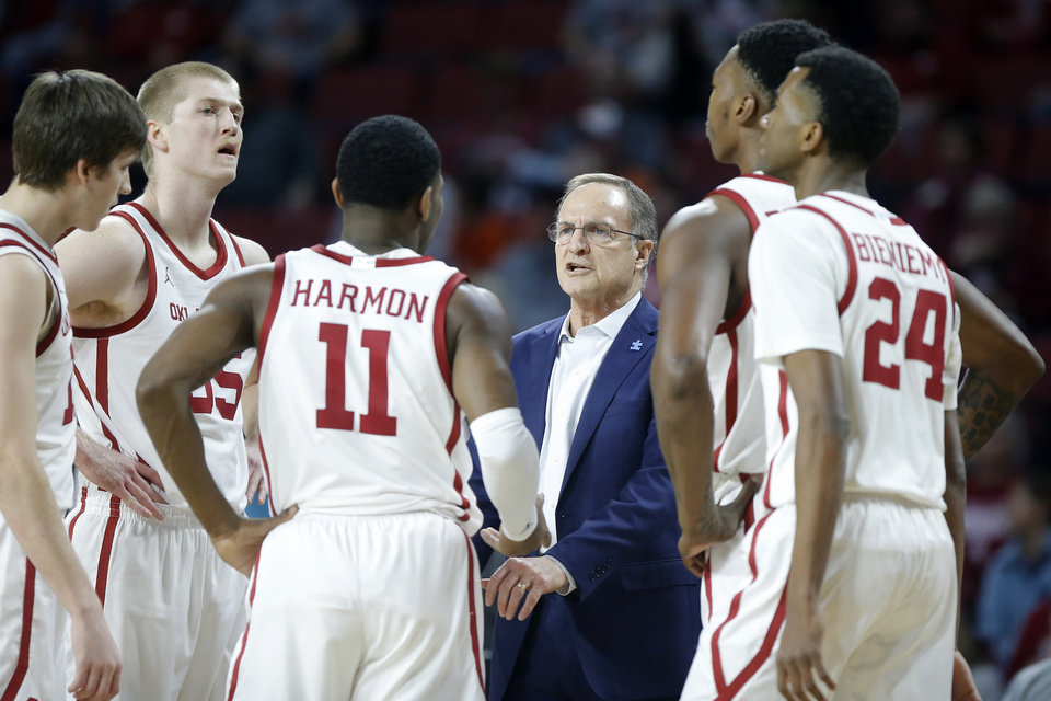 Photo - Oklahoma coach Lon Kruger talks with his team during a Bedlam college basketball game between the University Oklahoma Sooners (OU) and the Oklahoma State Cowboys (OSU) at the Lloyd Noble Center in Norman, Okla., Saturday, Feb. 1, 2020. Oklahoma won 82-69. [Bryan Terry/The Oklahoman]