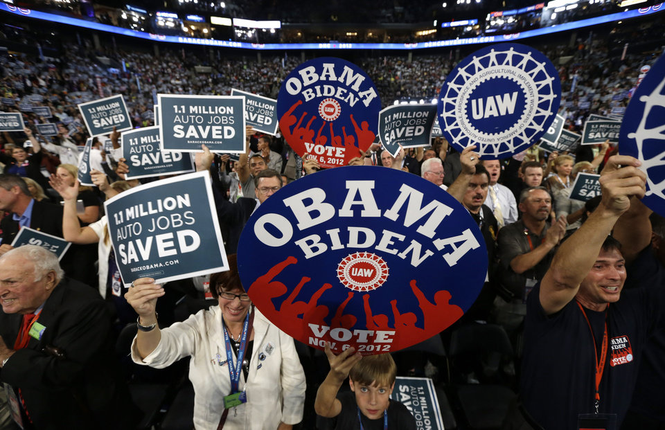 Photo - Delegates cheer during the Democratic National Convention in Charlotte, N.C., on Wednesday, Sept. 5, 2012. (AP Photo/Charles Dharapak)  ORG XMIT: DNC766