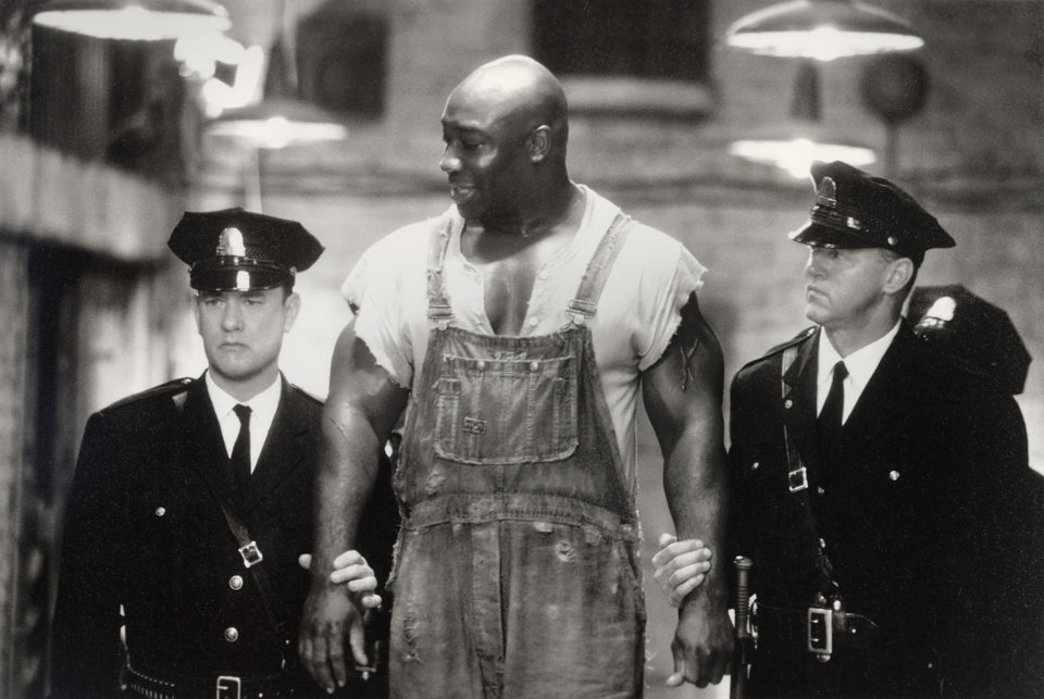 Photo -   This undated image provided by Warner Bros. shows Tom Hanks, left, Michael Clarke Duncan, center, and David Morse in