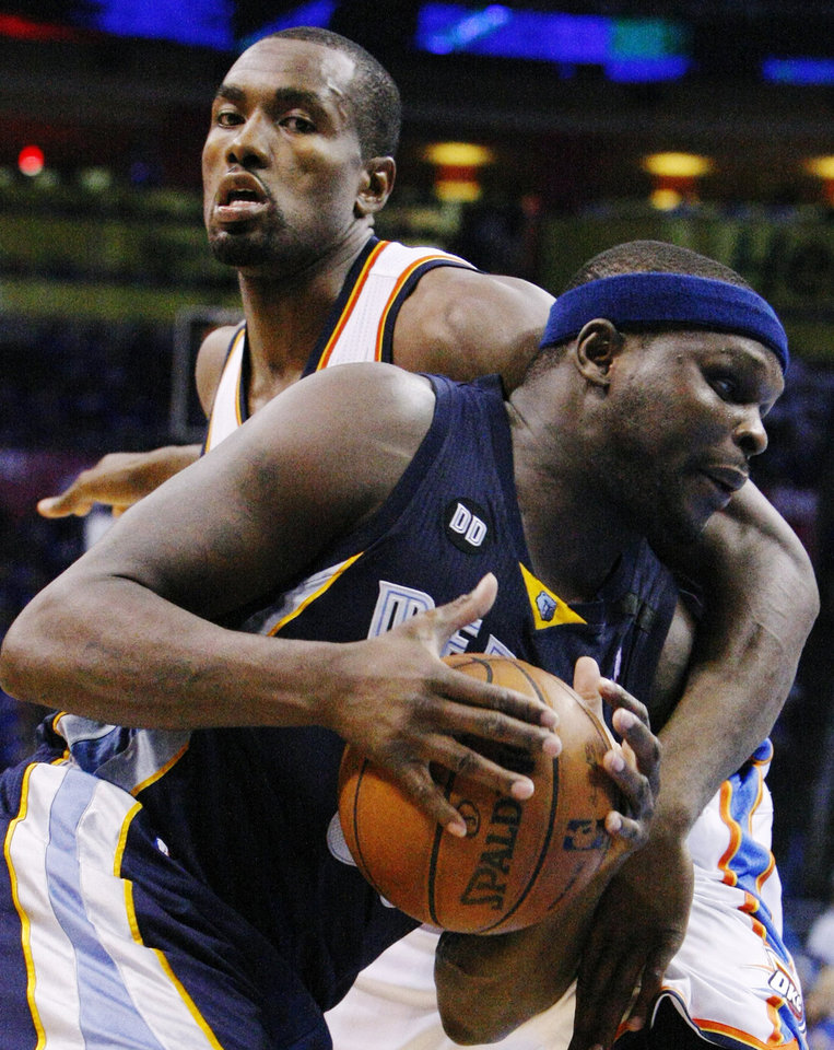 Photo - Memphis Grizzlies' Zach Randolph, front, drives against Oklahoma City Thunder's Serge Ibaka, rear, in the second half of Game 2 of their Western Conference semifinal NBA basketball playoff series Tuesday, May 7, 2013, in Oklahoma City. (AP Photo/Alonzo Adams)