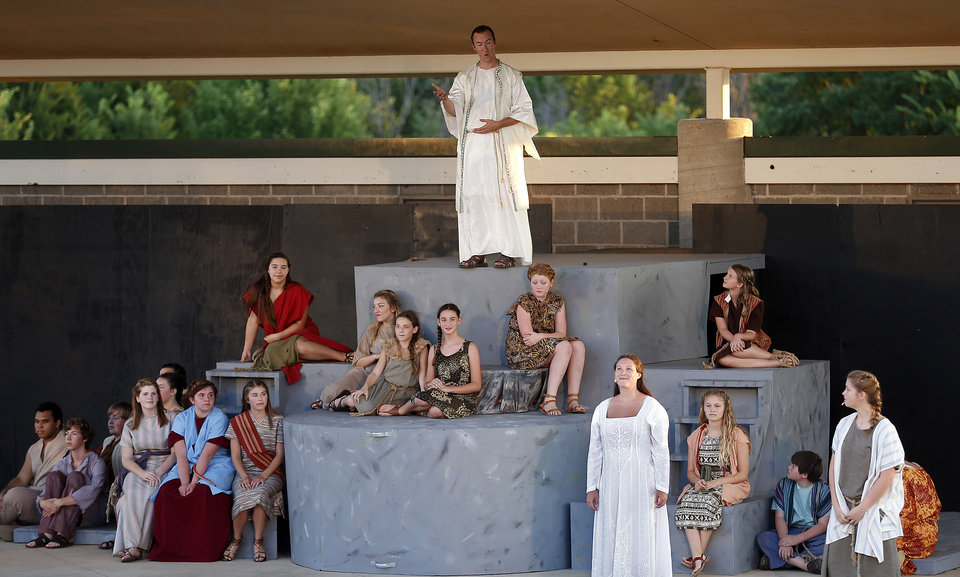 """Photo -  Aaron Kellert, top, performs  during Upstage Theatre's production of """"Children of Eden"""" at J.L. Mitch Park in Edmond. PHOTO BY SARAH PHIPPS, THE OKLAHOMAN   SARAH PHIPPS -"""