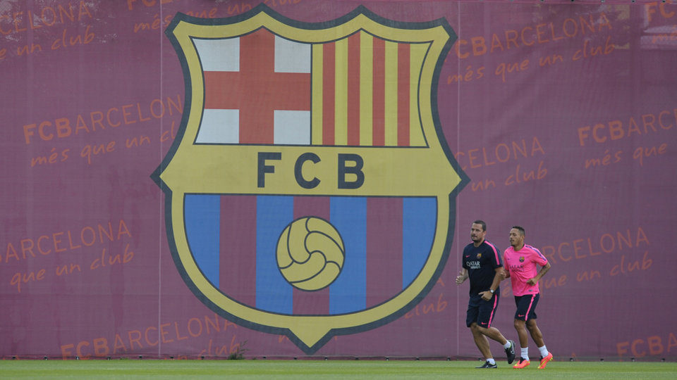 Photo - FC Barcelona's Adriano Correia, right, runs during a training session at the Sports Center FC Barcelona Joan Gamper in San Joan Despi, Spain, Friday, July 25, 2014. (AP Photo/Manu Fernandez)