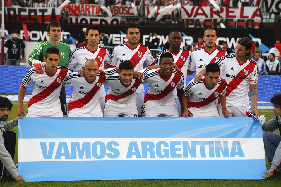 Photo - River Plate's players pose with a flag that reads in Spanish,