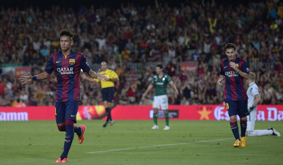 Photo - Barcelona's Neymar, from Brazil, left, reacts after scoring against Leon during the Joan Gamper trophy friendly soccer match at the Camp Nou in Barcelona, Spain, Monday, Aug. 18, 2014. (AP Photo/Manu Fernandez)