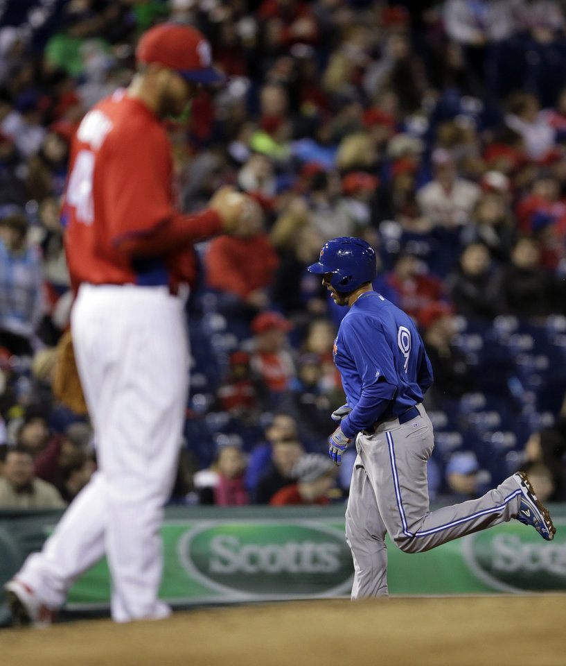 Toronto Blue Jays' J.P. Arencibia, right, rounds the bases after hitting a home run off Philadelphia Phillies relief pitcher Phillippe Aumont during the fifth inning of an exhibition baseball game, Friday, March 29, 2013, in Philadelphia. (AP Photo/Matt Slocum)