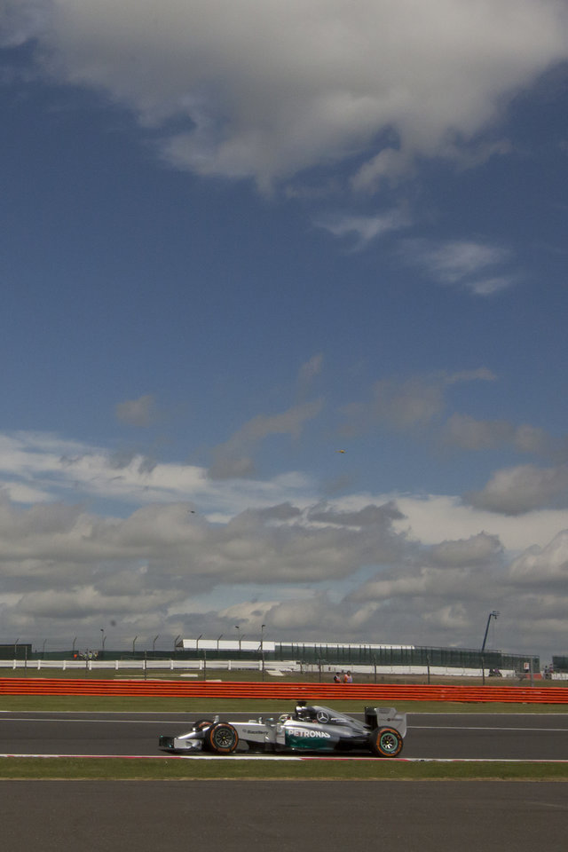 Photo - Mercedes driver Lewis Hamilton rounds the track during a practice session before the British Formula One Grand Prix at Silverstone, England, Friday, July 4, 2014. The British Formula One Grand Prix will be held on Sunday,  July 6, 2014. (AP Photo/Jon Super)