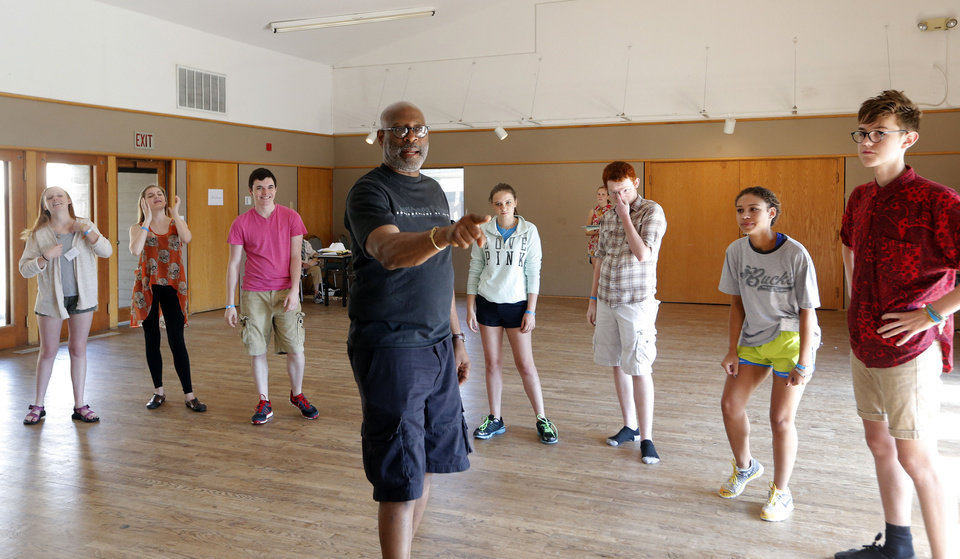 Photo - A. Dean Irby, an acting professor from New York City, leads his class through their vocal warm up during the Oklahoma Summer Arts Institute at Quartz Mountain Arts and Conference Center near Lone Wolf on Monday, June 17, 2013. PHOTO BY SARAH PHIPPS, The Oklahoman  SARAH PHIPPS