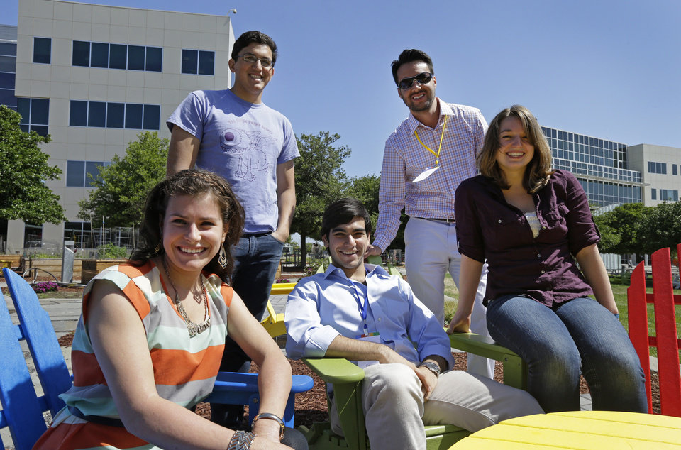 Photo - Google interns, from left, Rita DeRaedt, Alfredo Salinas, Alex Rodrigues, Steve Weddler, and Lizzy Burl stop for a photo on the Google campus Wednesday, May 21, 2014, in Mountain View, Calif. With summer's arrival comes an influx of thousands of Silicon Valley interns, and these kids aren't just fetching coffee.  Well paid and perked, young up-and-comers from around the world who successfully navigate the competitive application process are assigned big time responsibility at firms like Google, Facebook, Drop Box and Twitter, where executives hope that a fun and stimulating summer will motivate them to come back after graduation to launch careers. (AP Photo/Ben Margot)
