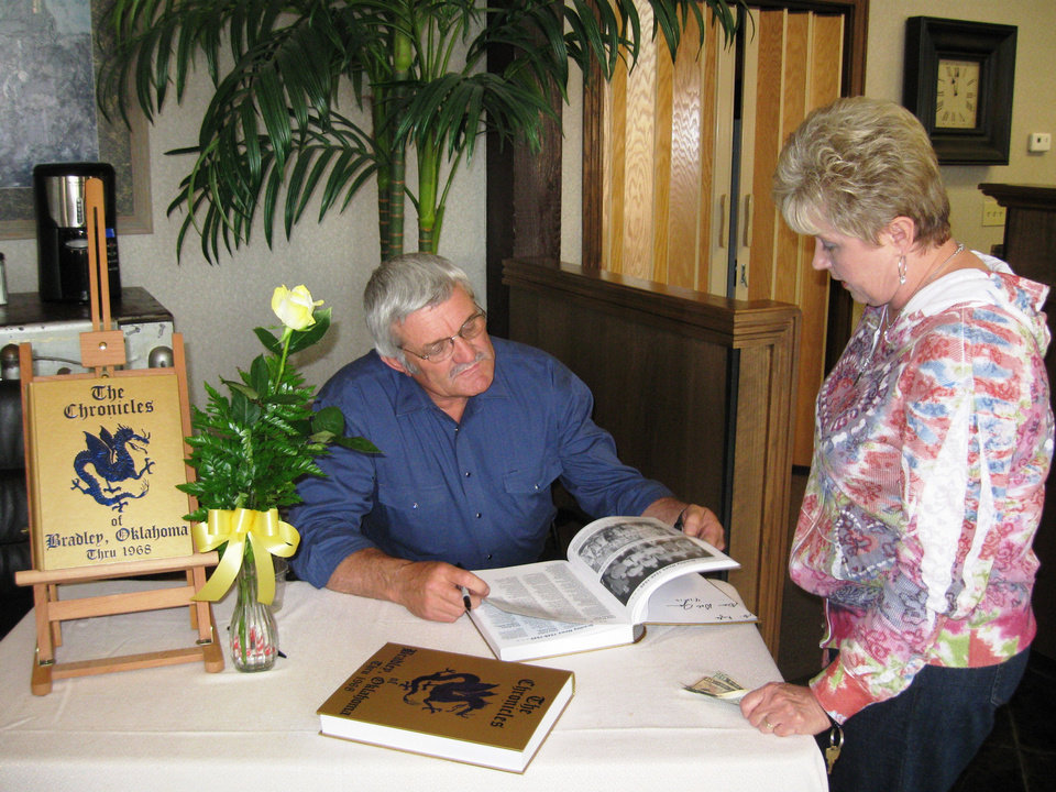 "From left, Dale Jones, editor of the new historical book ""The Chronicles of Bradley, Oklahoma Thru 1968,"" chats with Debra Williams at his book signing April 13 at the First National Bank of Lindsay. Williams, a Lindsay resident, bought a copy of the book for her son, Kyle English, 29, whose late father Ray English attended Bradley schools, as well as a copy for her former mother-in-law, Clara Faye Hughes. Photo by Brandy McDonnell, The Oklahoman. <strong></strong>"