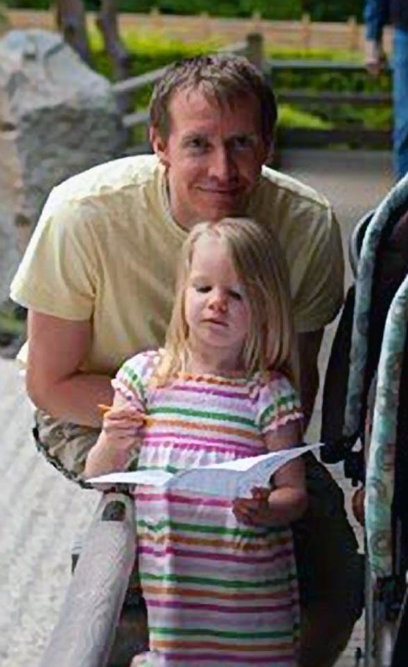 Photo - This photo posted to the Emilie Parker Fund Facebook page shows Emilie Parker and her father Robbie Parker. Fighting back tears and struggling to catch his breath, Robbie Parker the father of  6-year-old Emile Parker who was gunned down in Friday's school shooting in Connecticut told the world about a little girl who loved to draw and was always smiling, and he also reserved surprising words of sympathy for the gunman. (AP Photo/Emilie Parker Fund) ORG XMIT: NY113