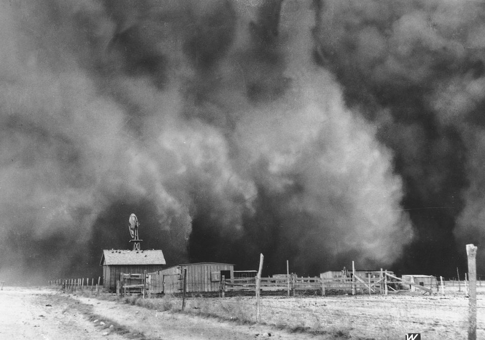 Photo - In this April 15, 1935, file photo, a ranch in Boise City, where the top soil dried and blew away, is about to be engulfed in a gigantic dust cloud in the Oklahoma Panhandle.  AP File Photo   Uncredited - AP