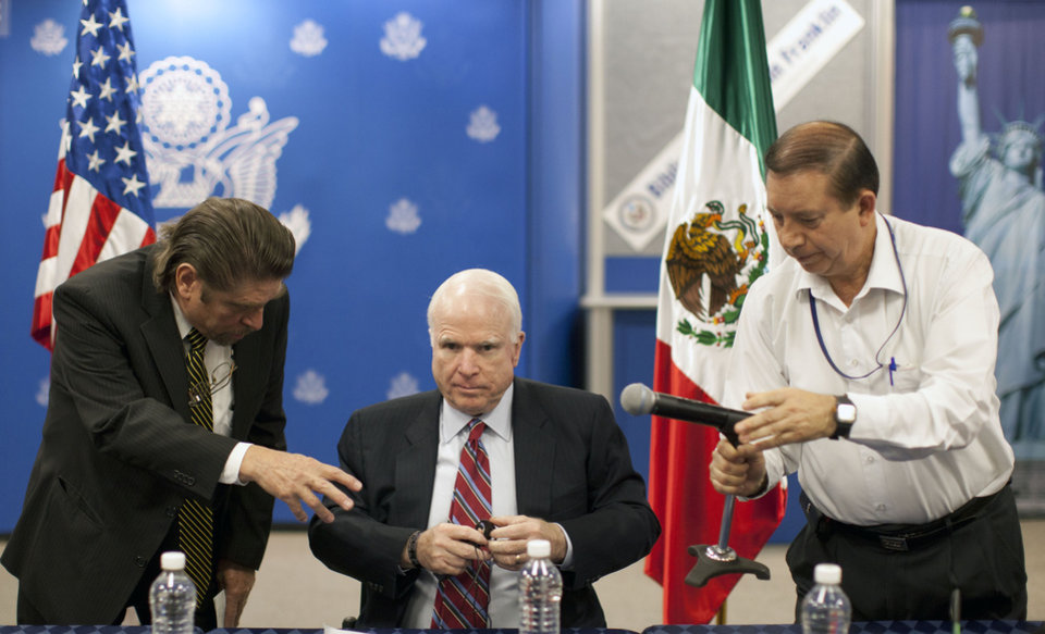 Photo - Republican Sen. John McCain from Arizona, center, gets ready for a press conference in Mexico City, Friday, Feb. 22, 2013. McCain says he is guardedly optimistic about producing an immigration reform proposal that includes a path to legalization for illegal immigrants but significant disagreement remains between President Obama and a group of lawmakers drafting a bill. (AP Photo/Alexandre Meneghini)