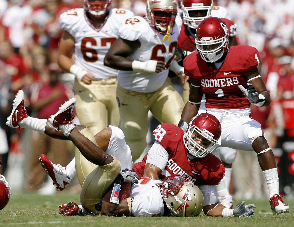OU\'s Travis Lewis brings down Greg Reid of Florida State as Tony Jefferson watches during the first half of the college football game between the University of Oklahoma Sooners (OU) and Florida State University Seminoles (FSU) at the Gaylord Family-Oklahoma Memorial Stadium on Saturday, Sept. 11, 2010, in Norman, Okla. Photo by Bryan Terry, The Oklahoman