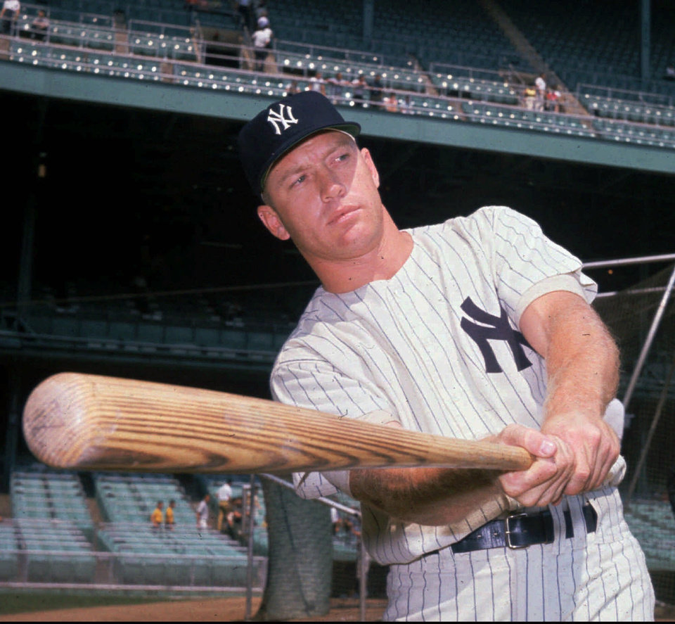 Photo - FILE--Major league baseball player Mickey Mantle takes a pre-game swing for the benefit of photographers at Yankee Stadium in 1961. Mantle was voted 35th of the top 100 athletes of the century by a selected panel assembled by The Associated Press. (AP PHOTO)